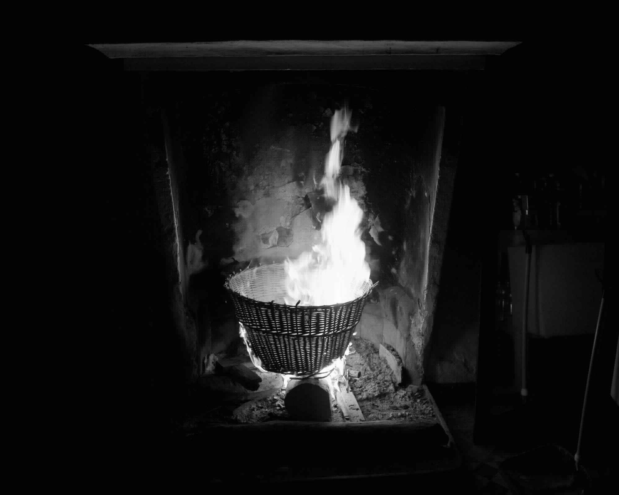 four photographs of burning objects in a fireplace
